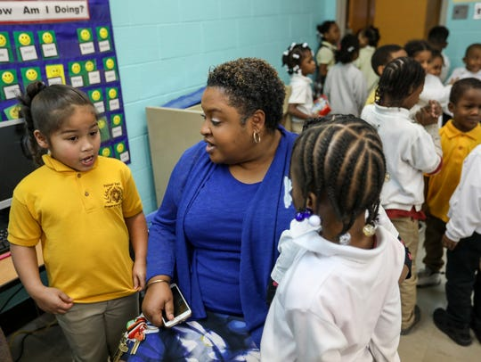 Principal Shirita Hightower talks with Amayah Gilmore, 6, of Detroit, left, in their kindergarten class at Palmer Park Preparatory Academy in Detroit on Thursday, Feb. 1, 2018.