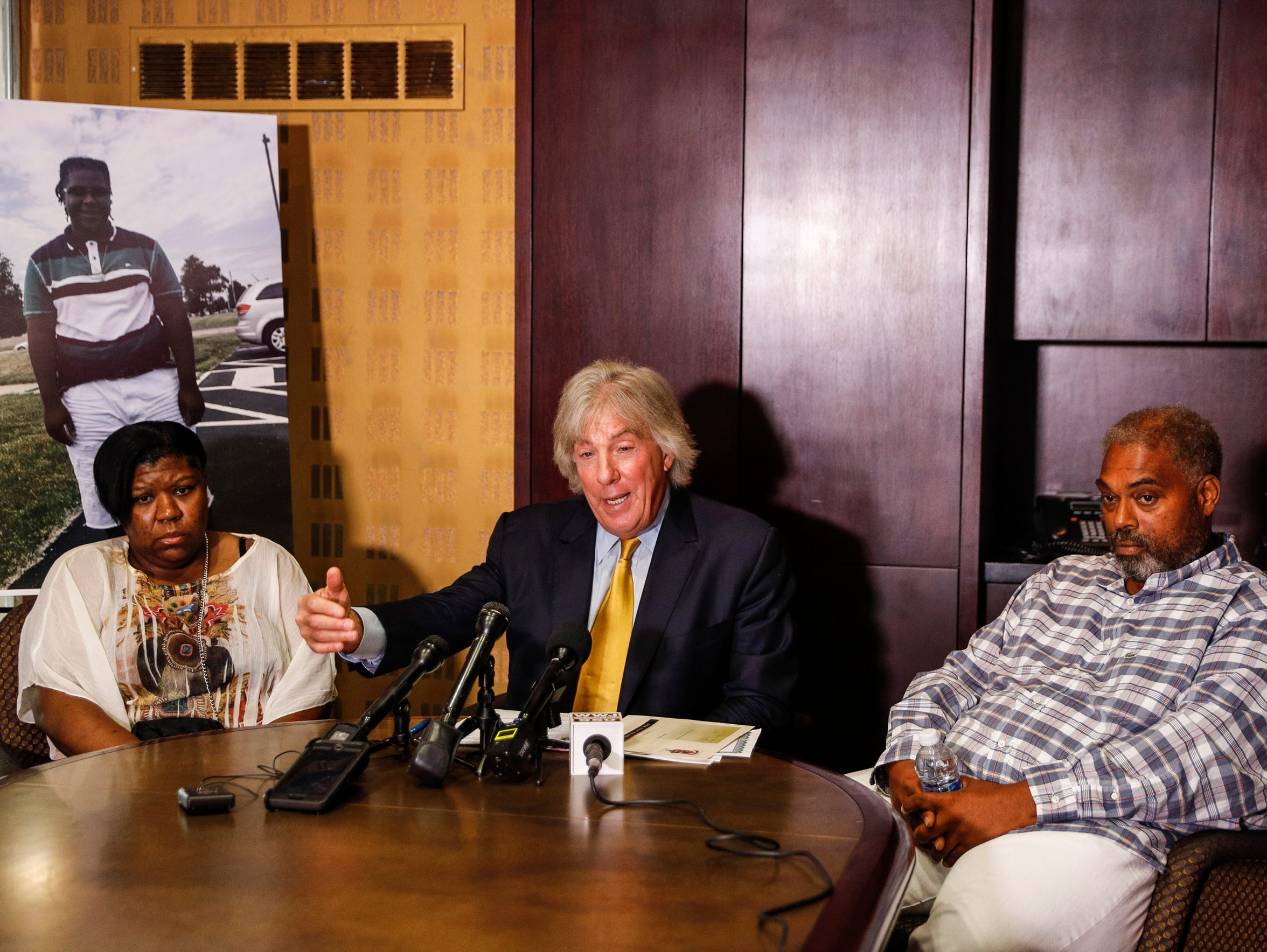 Monique Grimes, left, and John Grimes, right, with attorney Geoffrey Fieger, hold a news conference in August 2017 about the lawsuit over the death of 15-year-old Damon Grimes. Monique and John are Damon's parents.