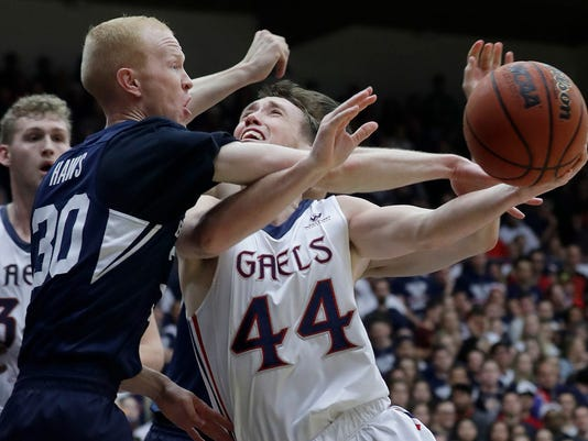 Saint Mary's guard Cullen Neal (44) loses the ball as he is guarded by BYU guard TJ Haws (30) during the first half of an NCAA college basketball game in Moraga, Calif., Thursday, Jan. 25, 2018. (AP Photo/Jeff Chiu)