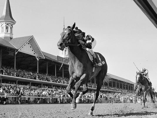 FILE - In this May 5, 1979, file photo, Spectacular Bid, ridden jockey Ronnie Franklin up, passes the twin spires of Churchill Downs to win the Kentucky Derby horse race in Louisville, Ky. Franklin, who rode Spectacular Bid to victory in the 1979 Kentucky Derby and Preakness, has died. He was 58. Franklin's nephew, Walter Cullum, said the former Maryland-based jockey died of lung cancer on Thursday, March 8, 2018. (AP Photo, File)