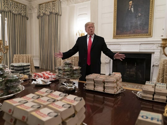 President Donald Trump presents fast food to be served to the Clemson Tigers football team to celebrate their Championship at the White House on Jan. 14, 2019, in Washington, D.C.