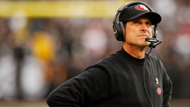 Jim Harbaugh is seen here during a break in the action against the Oakland Raiders in the fourth quarter at O.co Coliseum earlier this month.