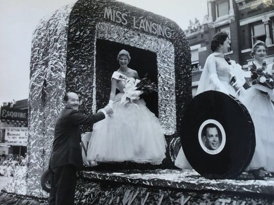 Patty Hildegard Hess, Miss Lansing, is greeted by Mayor Ralph W. Crego.
