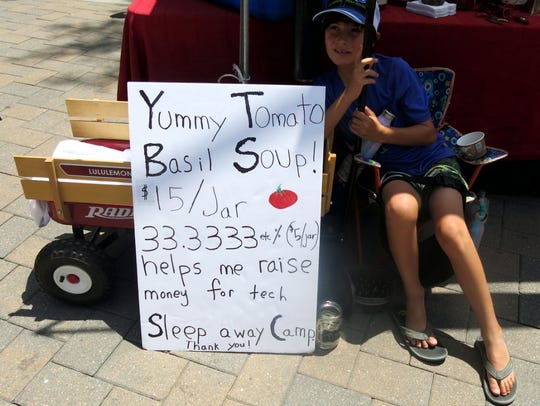 "Wyatt Hooker, 9,  selling Left Bank, Avon, Colo.'s ""Yummy Tomato Basil Soup"" at Vail Market. He was raising money for a ""sleep away camp."""