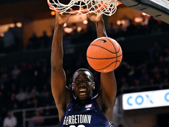 Jan 4, 2017; Providence, RI, USA; Georgetown Hoyas forward Akoy Agau (22) dunks and scores against the Providence Friars during the first half at the Dunkin Donuts Center.