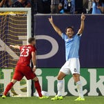 New York City FC midfielder Frank Lampard reacts after scoring a goal in front of Toronto FC defender Josh Williams.