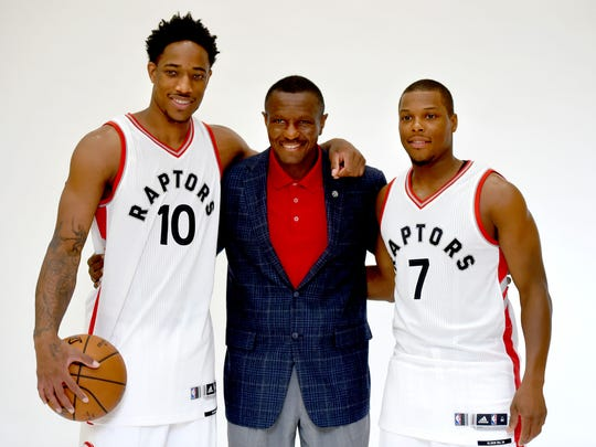 Toronto Raptors head coach Dwane Casey poses with guards DeMar DeRozan and Kyle Lowry during media day.
