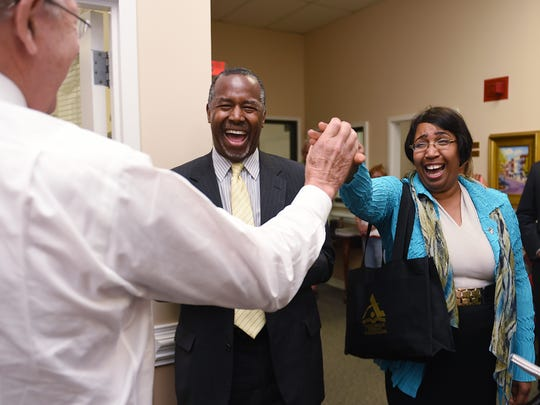 Candy Carson, wife of Dr. Ben Carson, middle, high-fives
