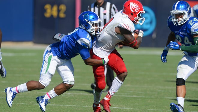 West Florida's Kevin Asante goes after West Alabama's Barnard McGhee during action Saturday at Blue Wahoos Stadium.