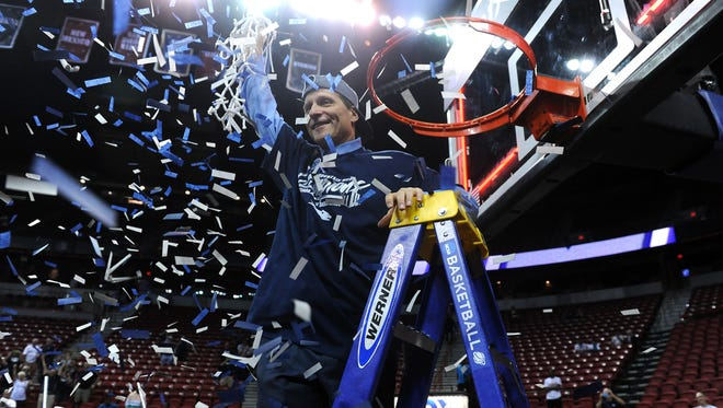 Nevada coach Eric Musselman cuts down the net after the Wolf Pack defeated Colorado State to win the Mountain West tournament title Saturday.