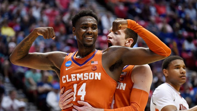 Clemson forward Elijah Thomas, front, celebrates a basket with forward David Skara during the first half of a second-round NCAA men's college basketball tournament game against Auburn on Sunday night in San Diego.