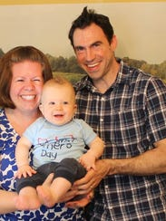 Cadence and Brian Hulme holding their son on Mother's