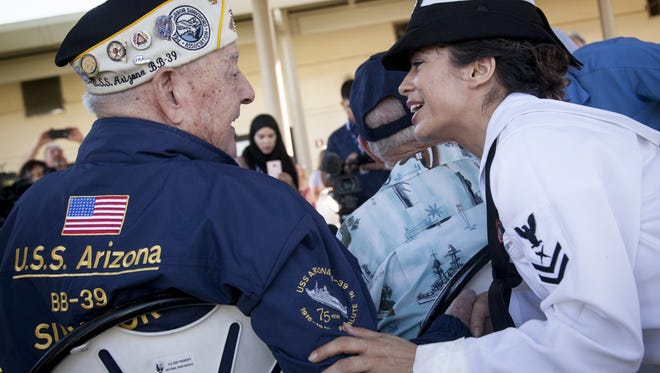 Navy linguist Sarah Meadows talks with USS Arizona survivor Lou Conter at the WWII Valor in the Pacific National Monument on Dec. 6, 2016, in Honolulu.