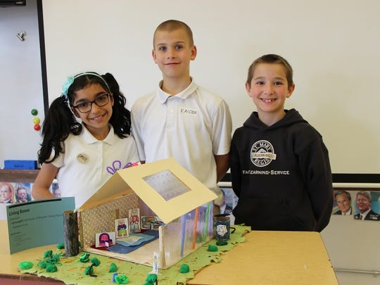 St. Mary fourth graders work on an architectural design project.