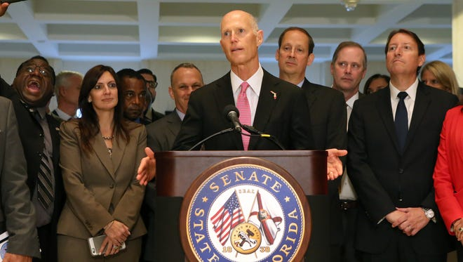 Gov. Rick Scott speaks to legislators at the end of the special session, Friday, June 9, 2017, in Tallahassee.