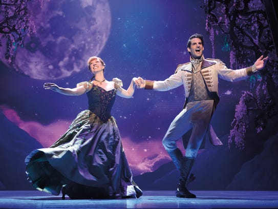Patti Murin as Anna and John Riddle as Hans dance together