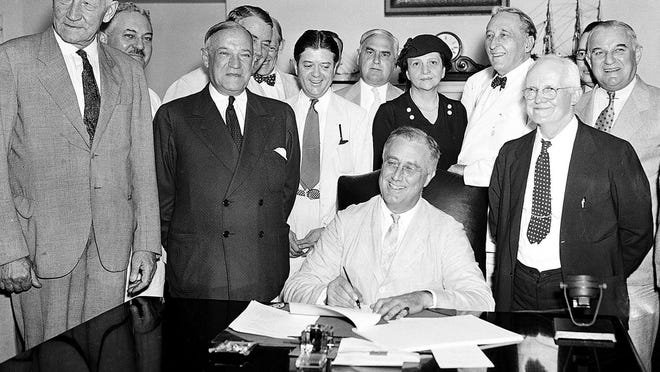 President Franklin D. Roosevelt signs the Social Security bill in Washington, D.C., on Aug. 14, 1935.