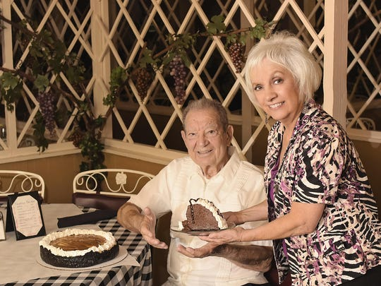 Sharon Smith offers her dad, Buzz Baudo, a piece of chocolate decadence or the Baudo's dessert of the day.