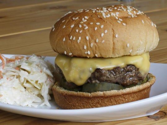 how to keep burgers flat