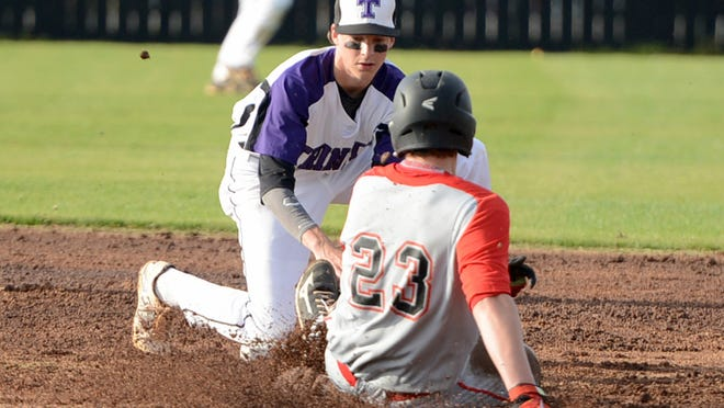 Adamsville's Kyle Slugger slides into second base against TCA earlier this season. Adamsville is just one of the local teams peaking right now.