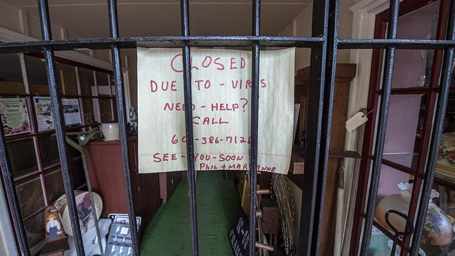 File - The owners of Philip's Furniture & Antiques shop on High Street in Burlington City, on Thursday, May 14, 2020, had posted that their shop is closed due to the virus, and if any customer needs help, call them. The shutdown of businesses, large and small, left millions out of work during the pnademic.