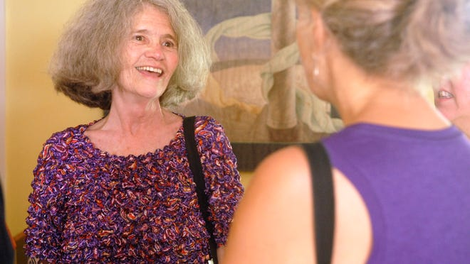 Below, Judi Jennings, executive director at the Kentucky Women's Foundation, laughs with friends at her retirement party at the KWF's Hopscotch House in Prospect. <137>June 22, 2014<137>
