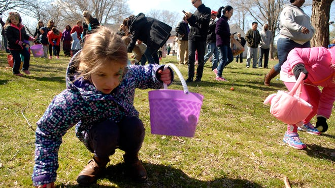 Payton Buckman, 7, gathers eggs at the Easter Egg Hunt in Lyndon. March 28, 2015