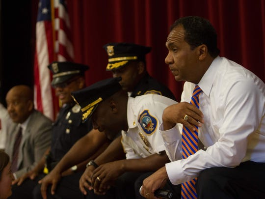 Mayor Dennis P. Williams (right) and Police Chief Bobby Cummings take part Wednesday in a town hall on violence at P.S. du Pont Middle School in Wilmington.