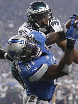 Lions wide receiver Calvin Johnson snags one of his three touchdown catches from Matthew Stafford in front of Philadelphia Eagles rookie cornerback Eric Rowe.