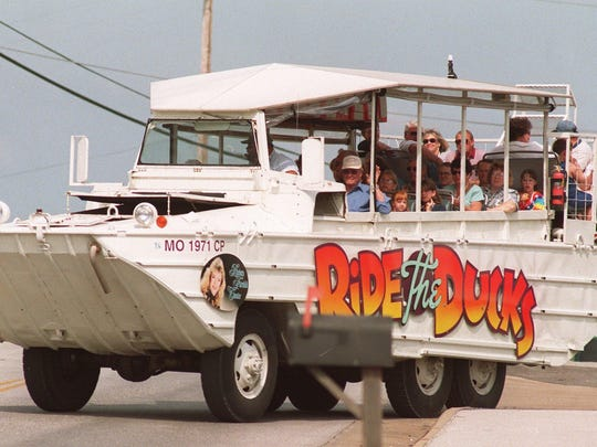 In this 1998 photo, a duck boat filled with passengers takes off from Ride the Ducks on HWY 76 in Branson.