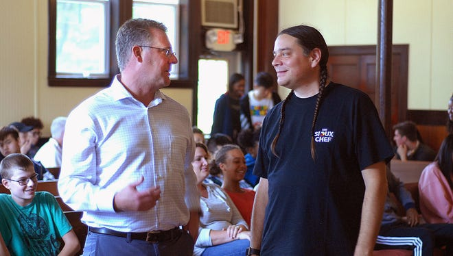 Oakwood Friends Head of School Chad Cianfrani, left, talks with Minnesota chef Sean Sherman during Monday's event at the Poughkeepsie campus.