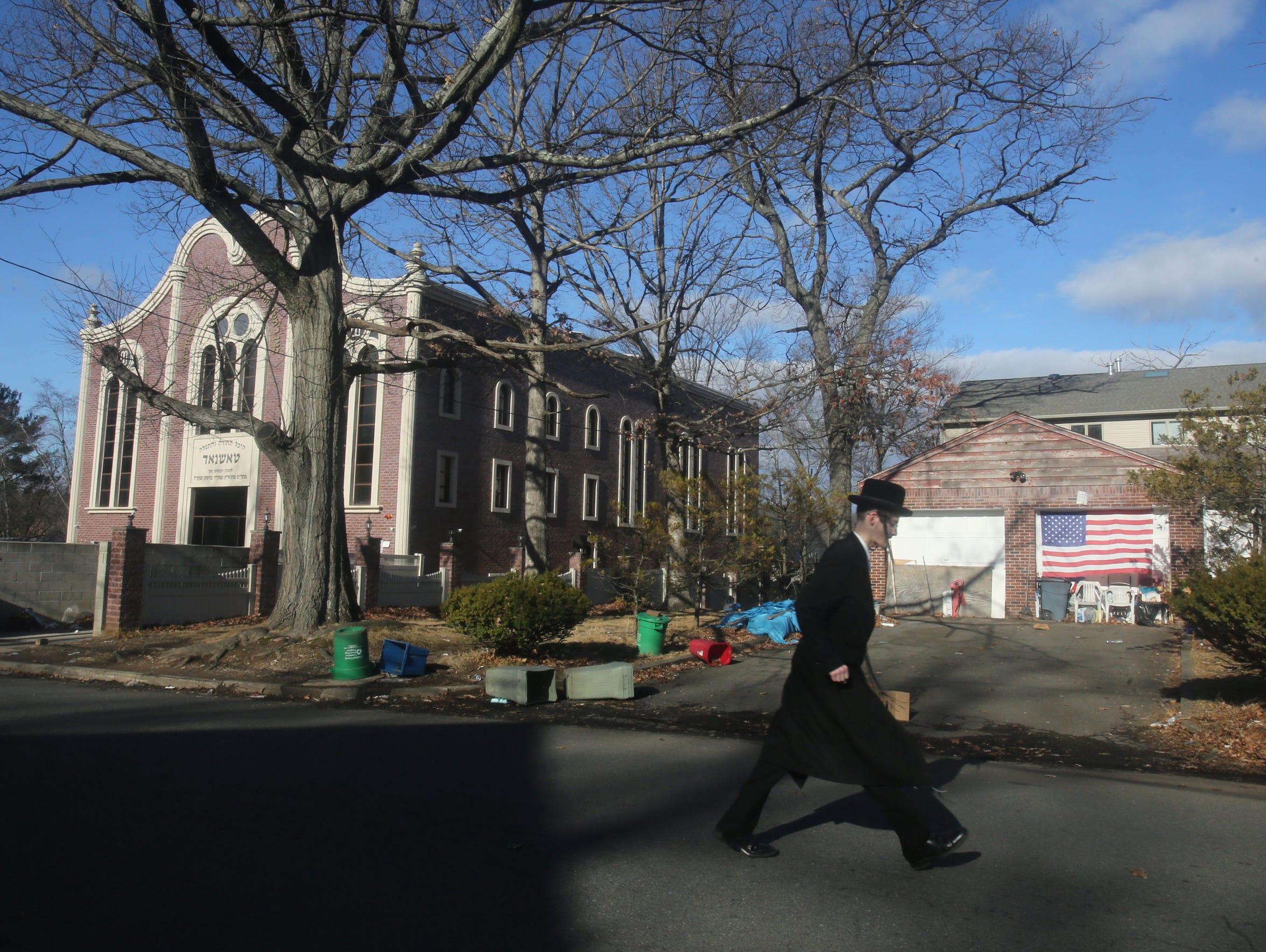 A man walks on Howard Place in Ramapo.