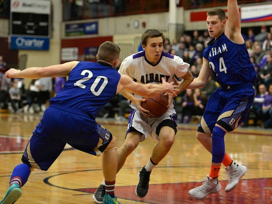 Albany's Neal Anderson (15) drives through Braham's