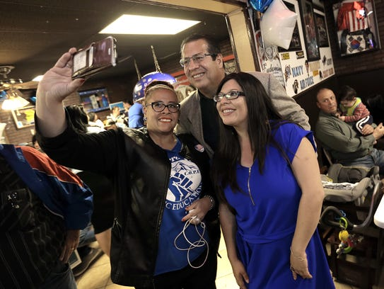 State Rep. Mary Gonzalez, right, takes photos with