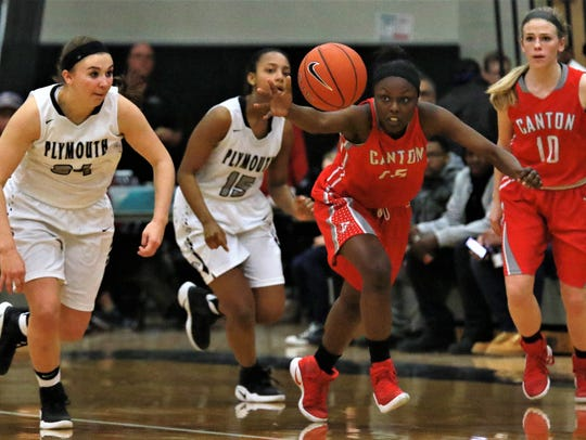 Canton's Shamya Butler (15) goes after the bouncing