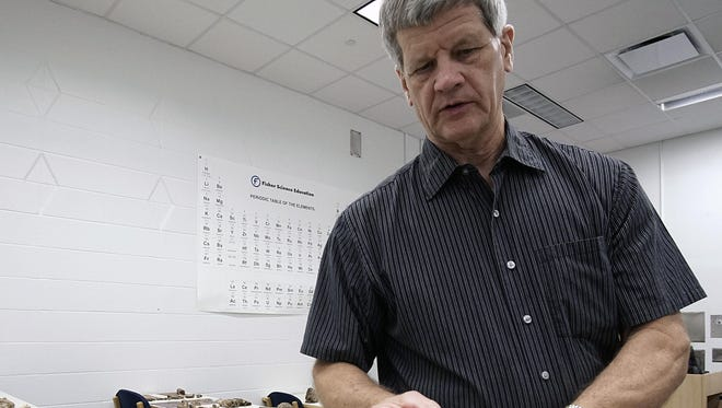 Nigel Brush, professor of geology, talks about a find during the presentation of the mastodon dig at Ashland University's Kettering Science Building.