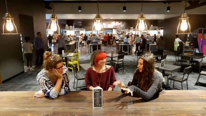 Kohl''s employees Arianna Caggiano (from left), Cassandra Genc and Jade Watring have a conversation in one of the new dining areas.