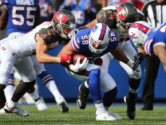 Bills linebacker Matt Milano is tackled after his interception.