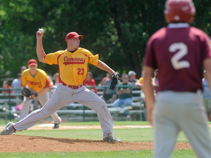Canova's #23 Lincoln Gassman pitches against Platte during the first round of State Amateur Baseball Tournament in Mitchell, S.D., Sunday, Aug., 10, 2014.
