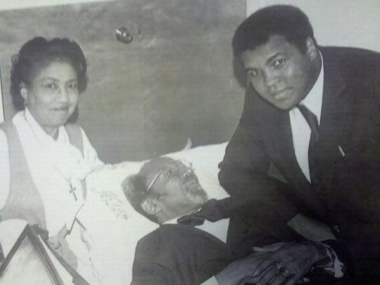 Muhammad Ali visits with the Rev. C.K. Steele who was