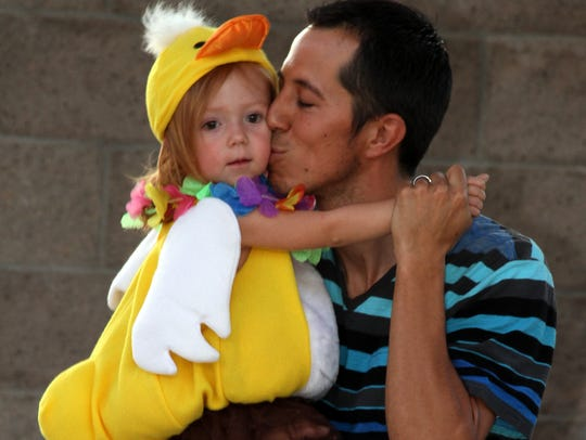 Daddy had kisses for his dancing duck.