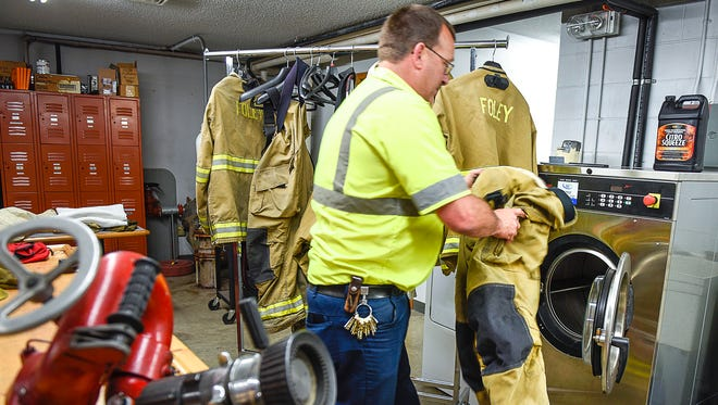 Foley Fire Chief Mark Pappenfus shows the department's washer-extractor used to wash firefighters' turnout gear after being used at a fire Wednesday, May 17, in Foley. Washing the gear removes harmful carcinogens, soot and other chemicals that firefighters come into contact with.