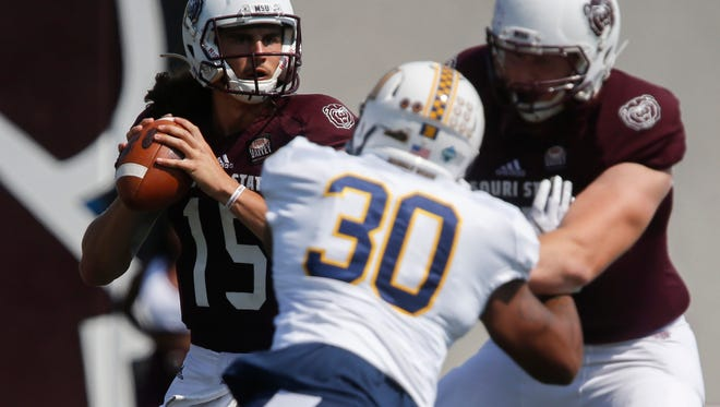 Missouri State University quarterback Peyton Huslig looks for an open receiver in the Bears home opener against Murray State on Saturday, Sept. 16, 2017.