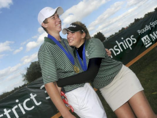 Lauren Parrini embraces her brother, Joe, after the York Catholic duo won District 3 Class AA titles Saturday at Briarwood Golf Club. They became the first siblings to win district championships on the same day. (Jason Plotkin -- GameTimePA.com)