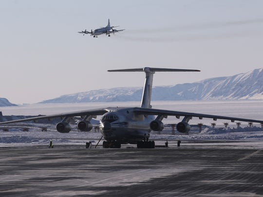 NASA's Operation IceBridge research aircraft, top,  lands at Thule Air Base on March 24, 2017 in Pituffik, Greenland. NASA's Operation IceBridge is flying research missions out of Thule Air Base and other Arctic locations during their annual Arctic spring campaign.