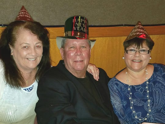 Peggy Montepare, left, with Bobi and Nati Irizzary have their party hats on and are ready to ring in 2018 at the Fort Pierce Elks Lodge.