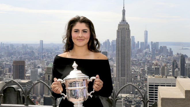 In this Sept. 8, 2019, file photo, Bianca Andreescu poses with the U.S. Open women's singles championship trophy at Top of the Rock in New York. New York Gov. Andrew Cuomo said Tuesday that the tournament will held starting in late August as part of the state's reopening from shutdowns caused by the coronavirus pandemic.