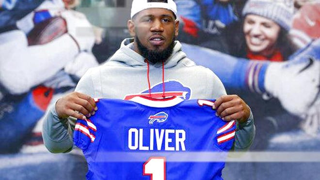 Buffalo Bills first round draft pick Ed Oliver posing for photographs following an April 27, 2019, news conference in Orchard Park New York.