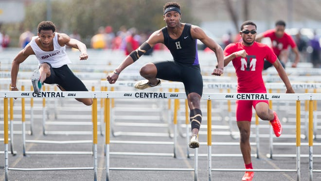 Louisville Male High School's Darian Clyburn hits the last hurdle on his way to winning the Boy's 110 Meter Hurdles during the Lenny Lyles Invitational Track meet at Louisville Central High School.