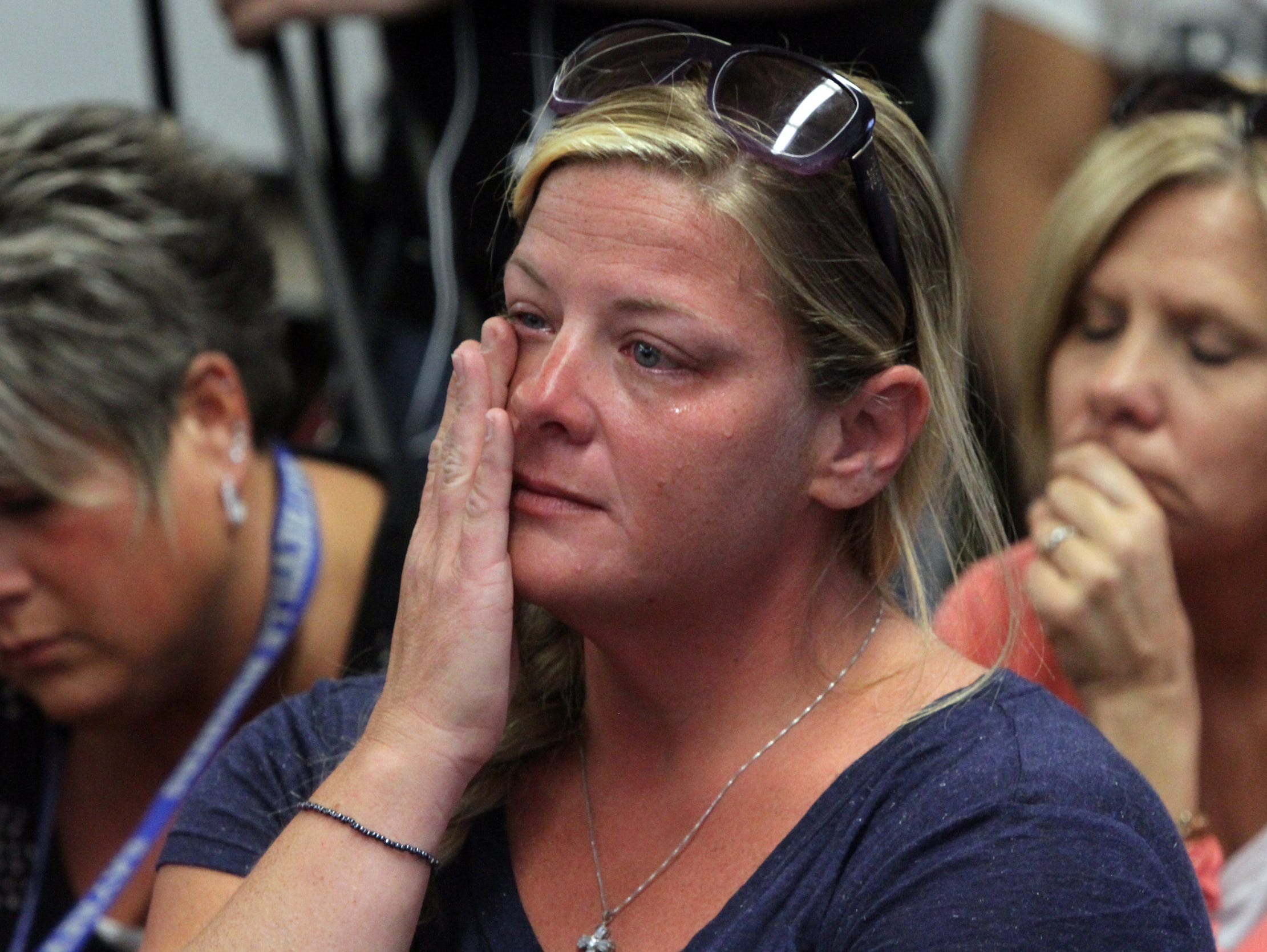A concerned mother of a Sayreville High School football player wipes tears from her eye during the press conference. On Friday October 3,,2014 Photo: Mark R. Sullivan/Staff Photographer